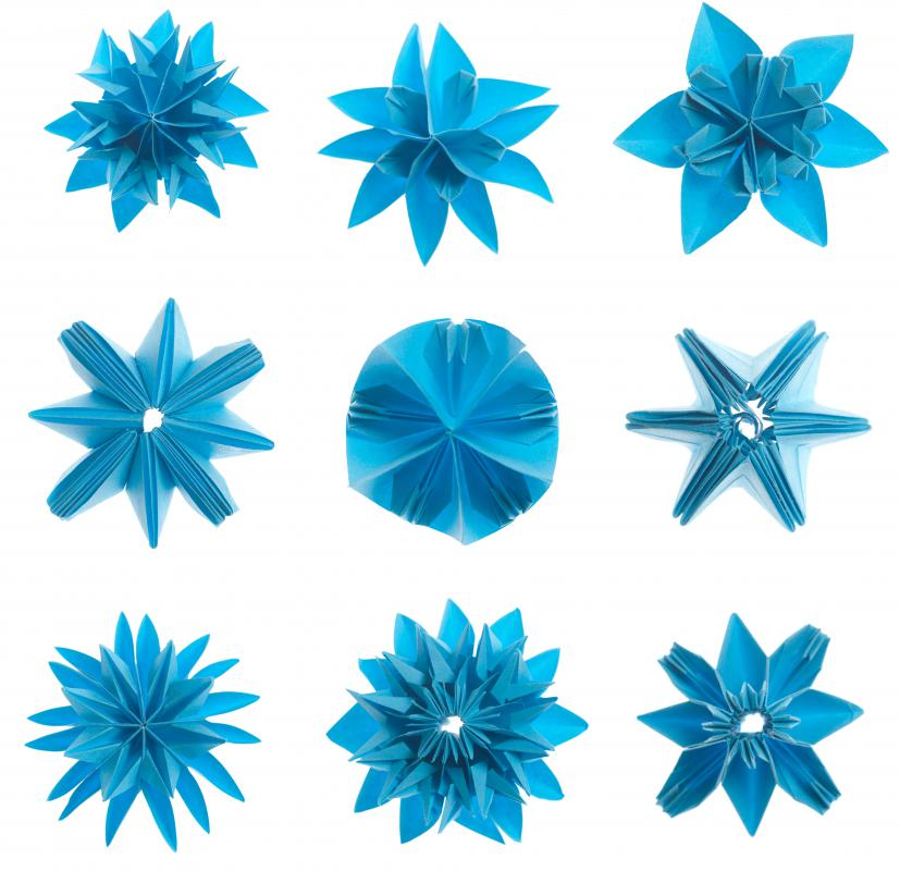 Compound origami using multiple sheets can produce complex, repeated designs.