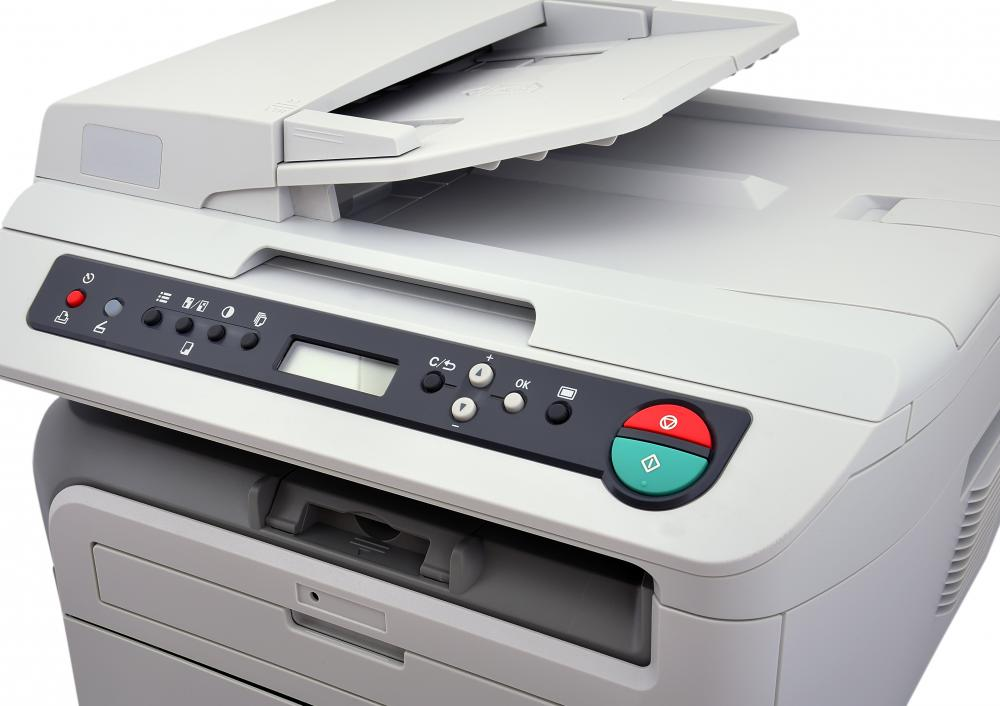 A copier is used to reproduce an original, making hard copies.
