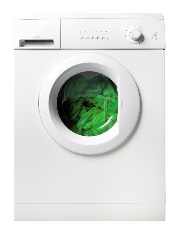 A washing machine with towels in it.