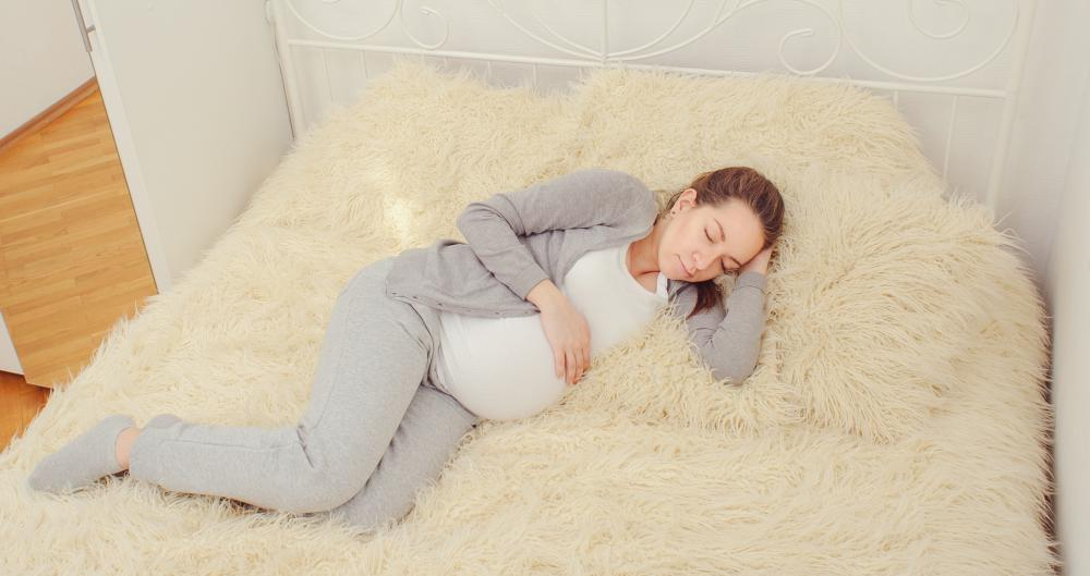 A pregnant woman with twins may need to be on bed rest.