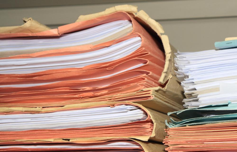 A court clerk files and maintains records and copies of important documents.
