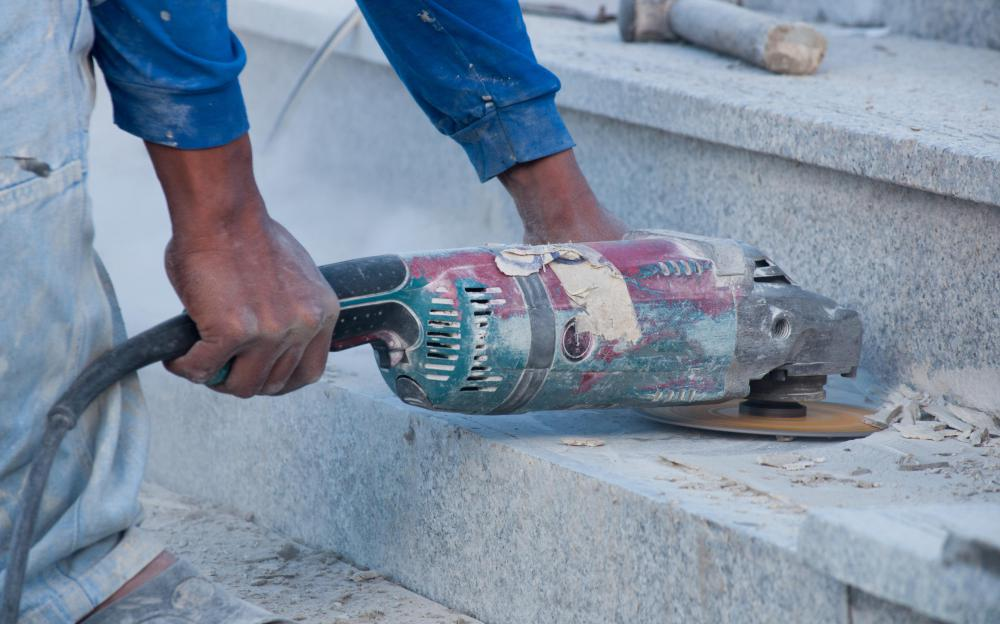 An abrasive saw may be used to smooth down hard materials like concrete.