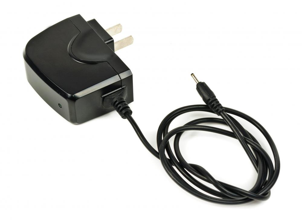 An AC adapter is used to transfer electricity from a wall outlet to a electronic device, such as a cell phone.