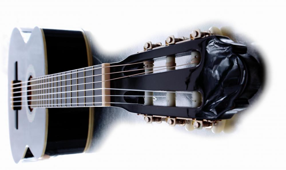 A capo is placed on the neck of a guitar, or, often, a banjo.