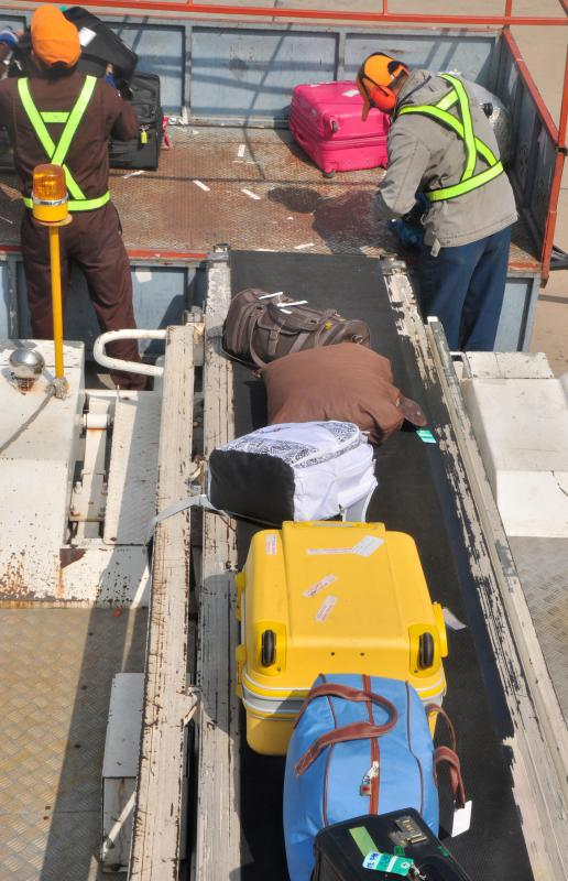 A main task of a ramp agent is to load and unload baggage from an airplane.
