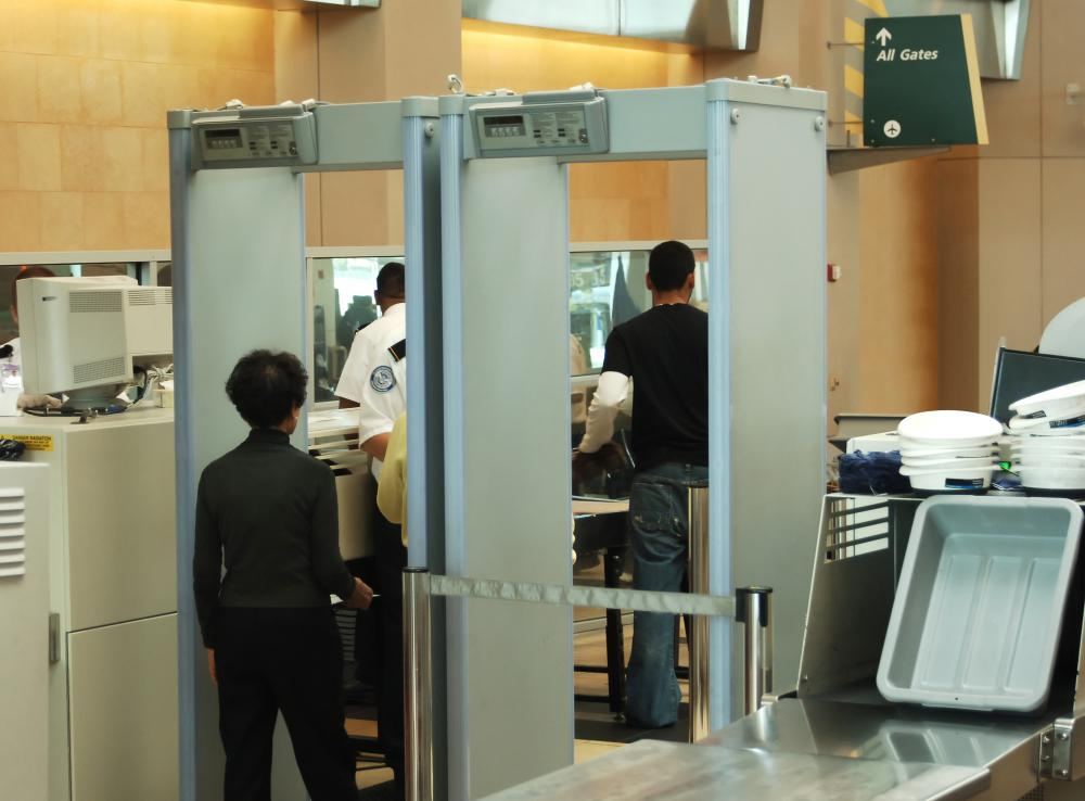 Travelers should remove their metal jewelry before they enter the metal detectors.