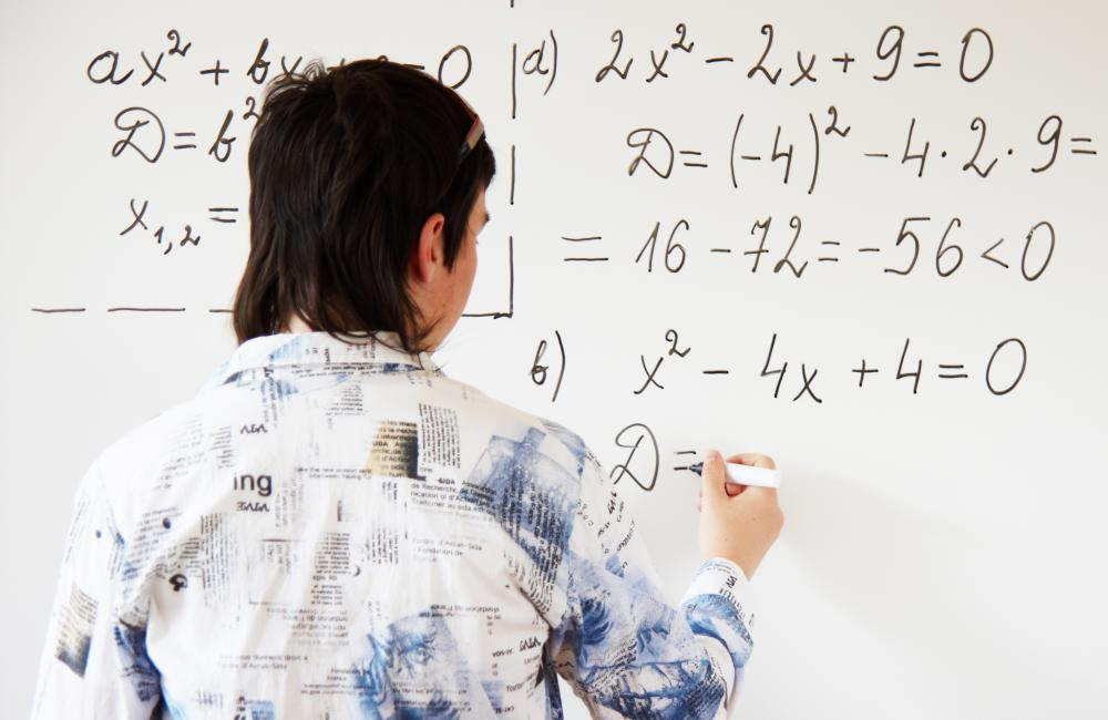 Problems featuring quadratic equations may be included on an achievement test.