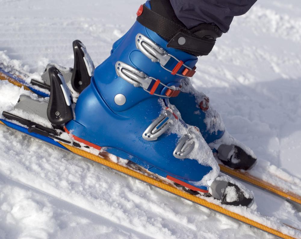 Alpine, or downhill, skis keep the booted foot attached to the ski.