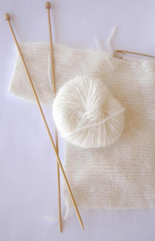 Angora wool may be harvested from Angora rabbits to create a soft, silky yarn.