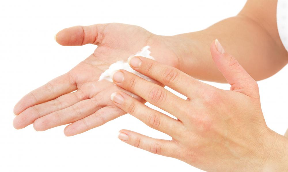 A woman using Dead Sea hand cream.
