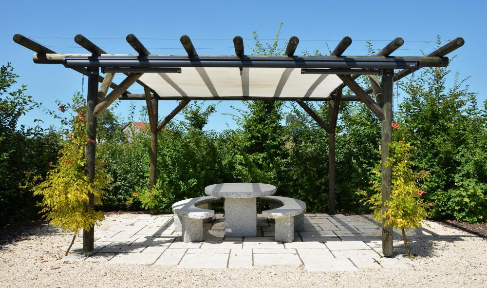 A flat surface is necessary for a free-standing pergola.