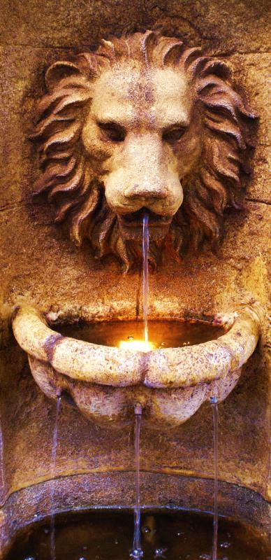 A solar powered fountain with a lion's face.