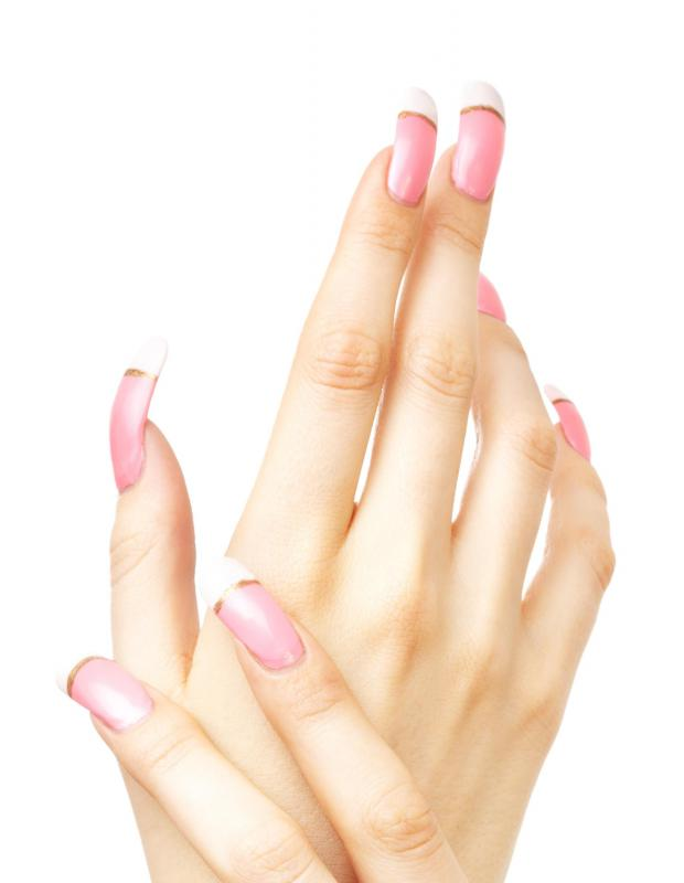 Artificial fingernails applied by a mobile nail technician.