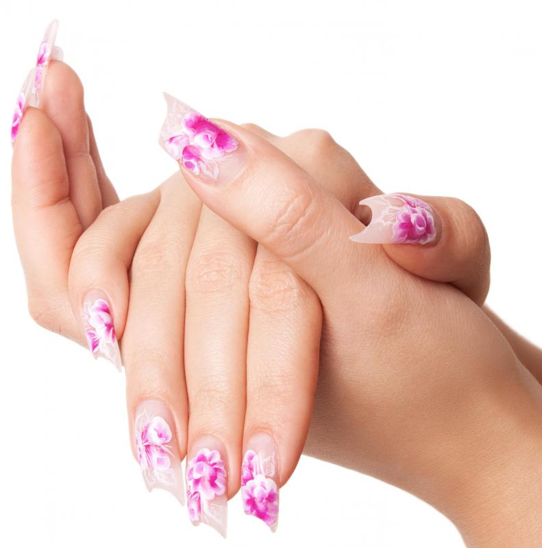 A woman with a manicure from a salon.
