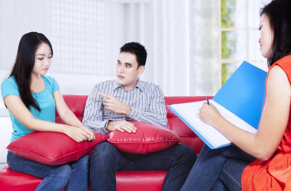A couples therapist helps couples work out their relationship problems.