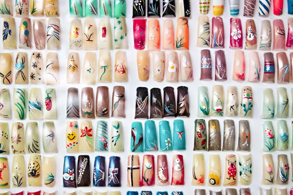Artificial fingernails with nail art.