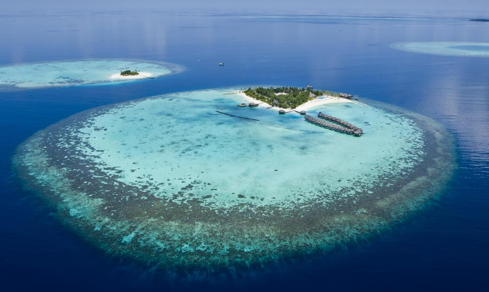 The central lagoons of atolls are formed by coral growth and volcanic activity.