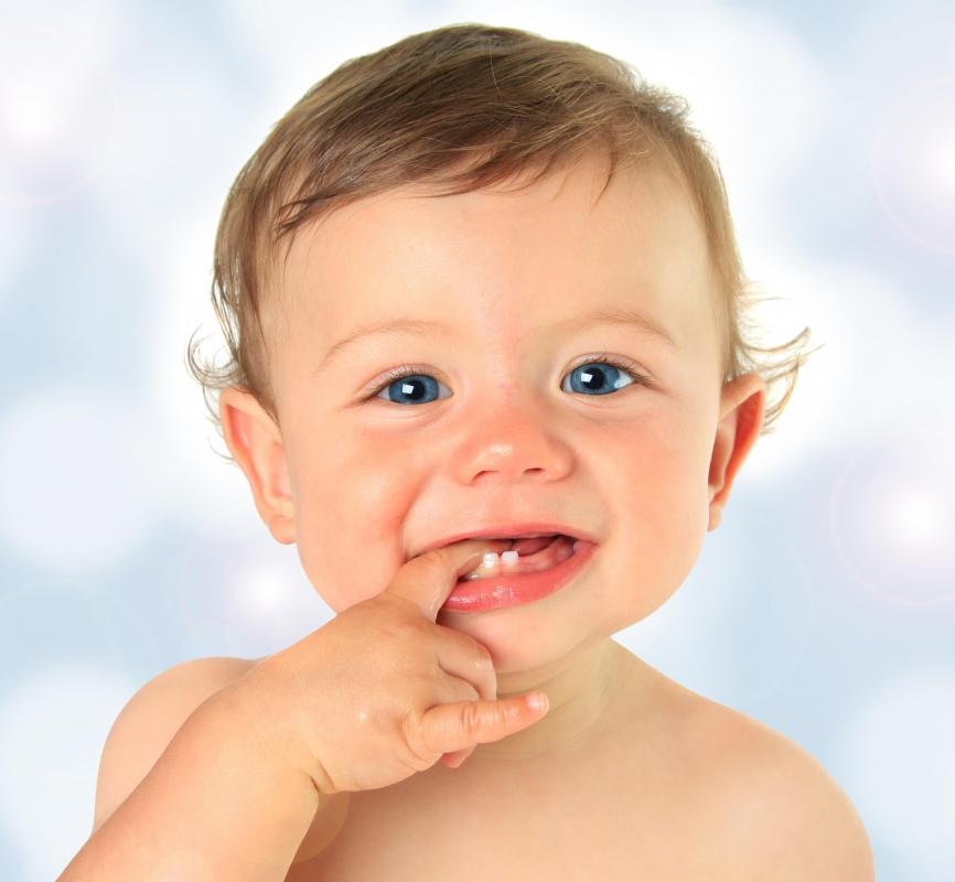 Primary teeth begin appearing around the age of six months.