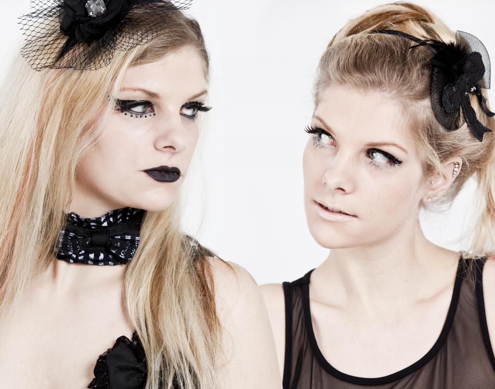 Goth clothes are black or dark-colored clothes that are paired with goth-style accessories and makeup.