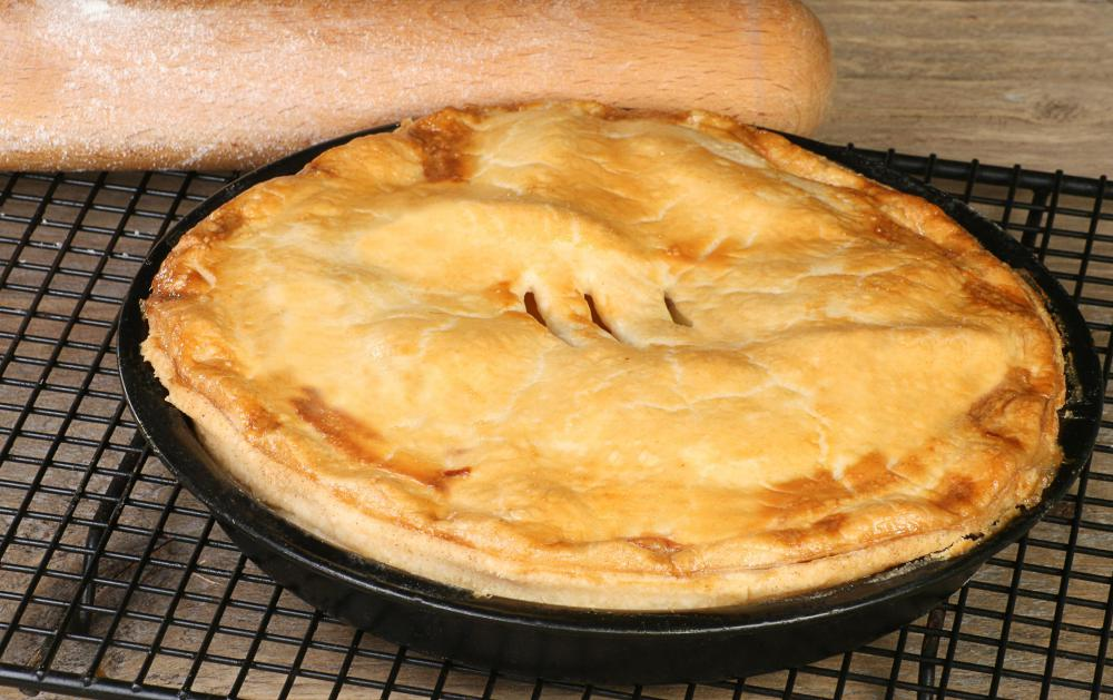 A person attending a potluck might bake a pie.