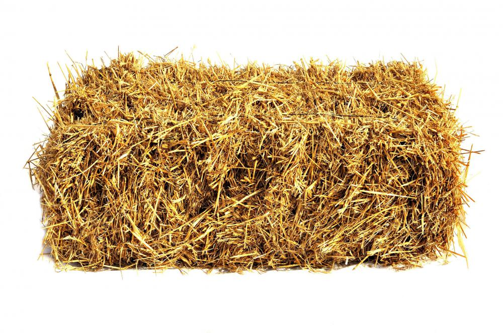 A bale of hay produced from a hay baler.