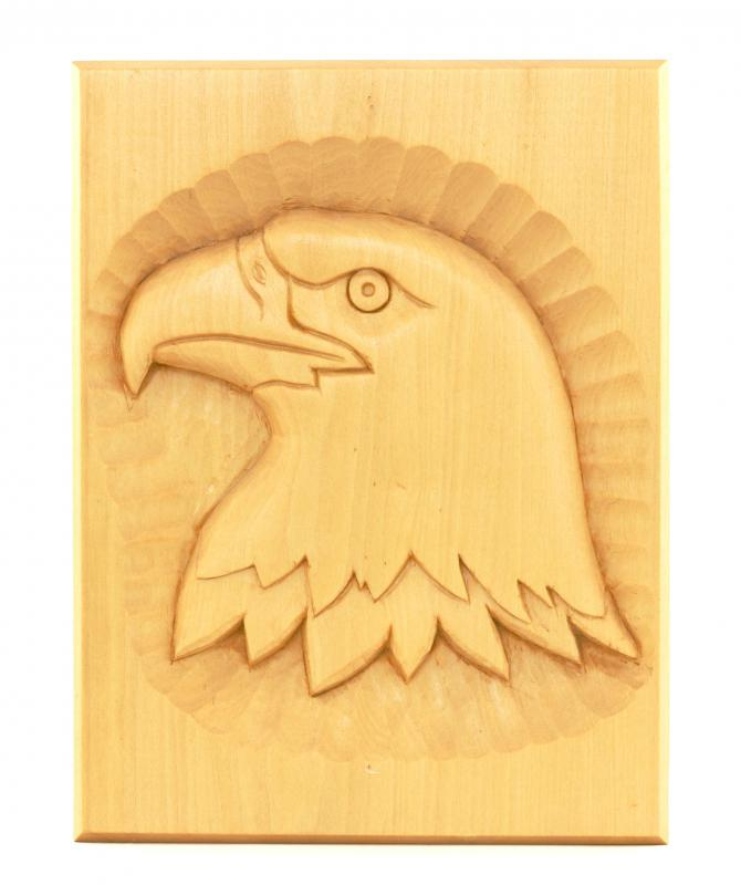 An eagle carved into balsa wood.