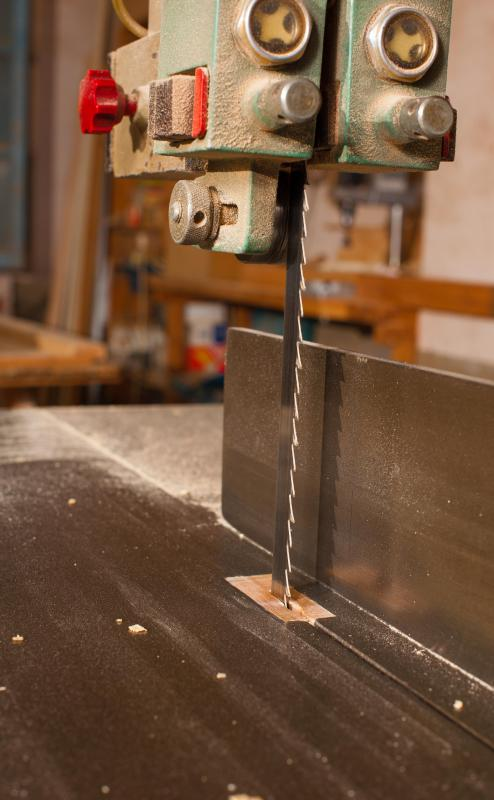 Bandsaws are most commonly used to make straight cuts in wood, but can also be used on metal.