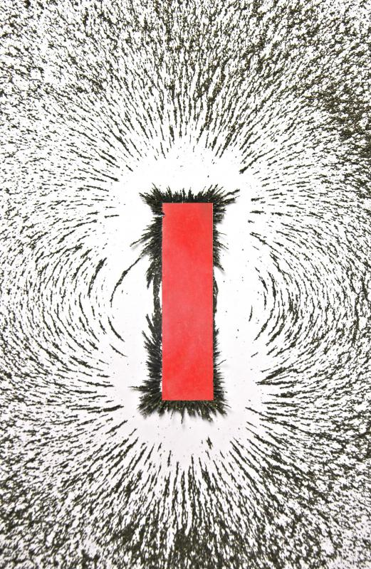 Bar magnet with iron filings to illustrate the magnetic field.
