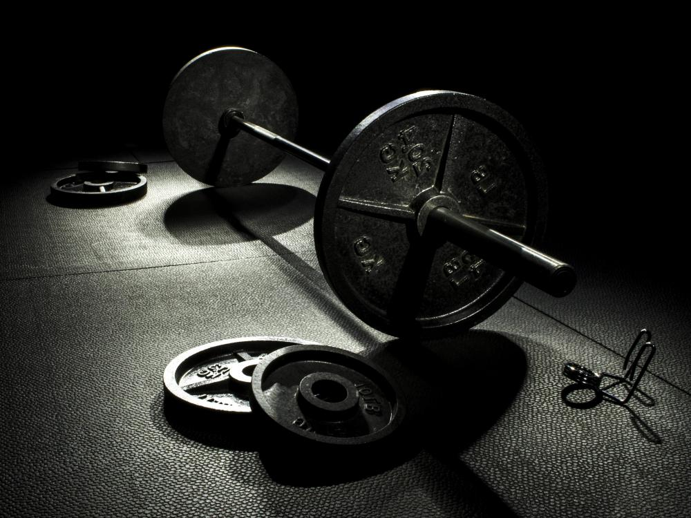 The Olympic-style barbell is commonly used when performing squats, but dumbbells and no weights at all can be used, also.