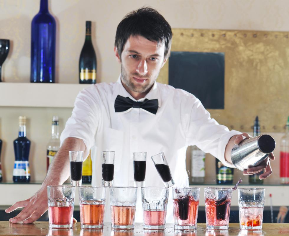 A professional bartender may serve drinks at a cocktail party.