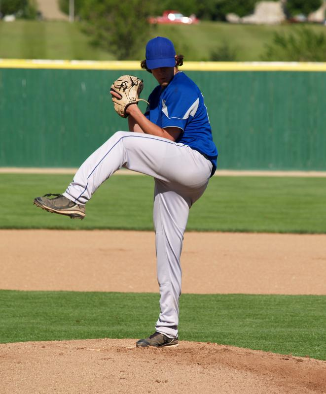 A baseball pitcher throws from the mound.