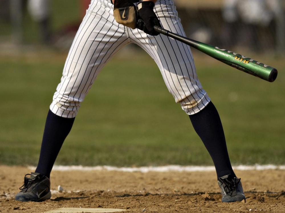 In height, the strike zone encompasses the area from a batter's knees up to the chest.