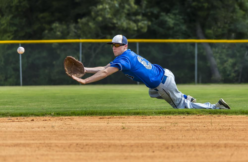 Cleats enable infielders to maintain some traction against the dirt that forms the baseline while fielding a hit.