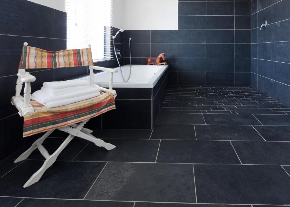 Bathroom tiles can look nice and provide a little traction for bare feet.