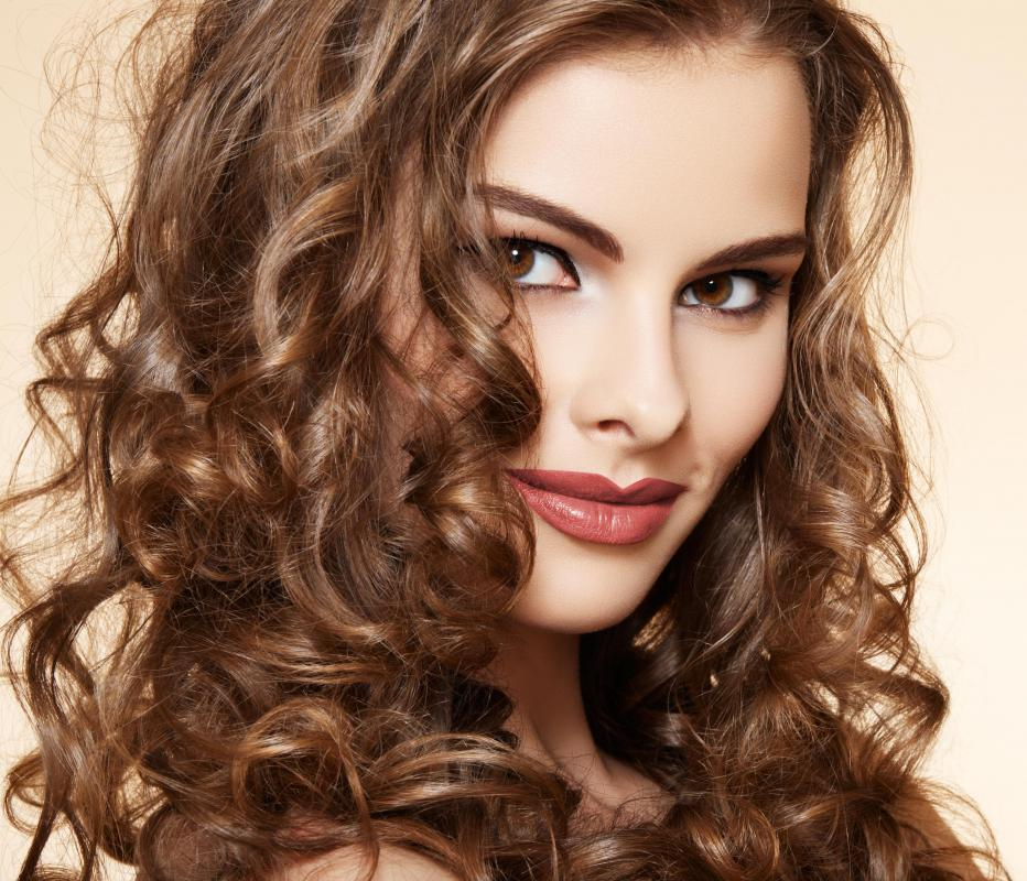 Curly hair types can benefit from a tourmaline or ceramic large curling iron.