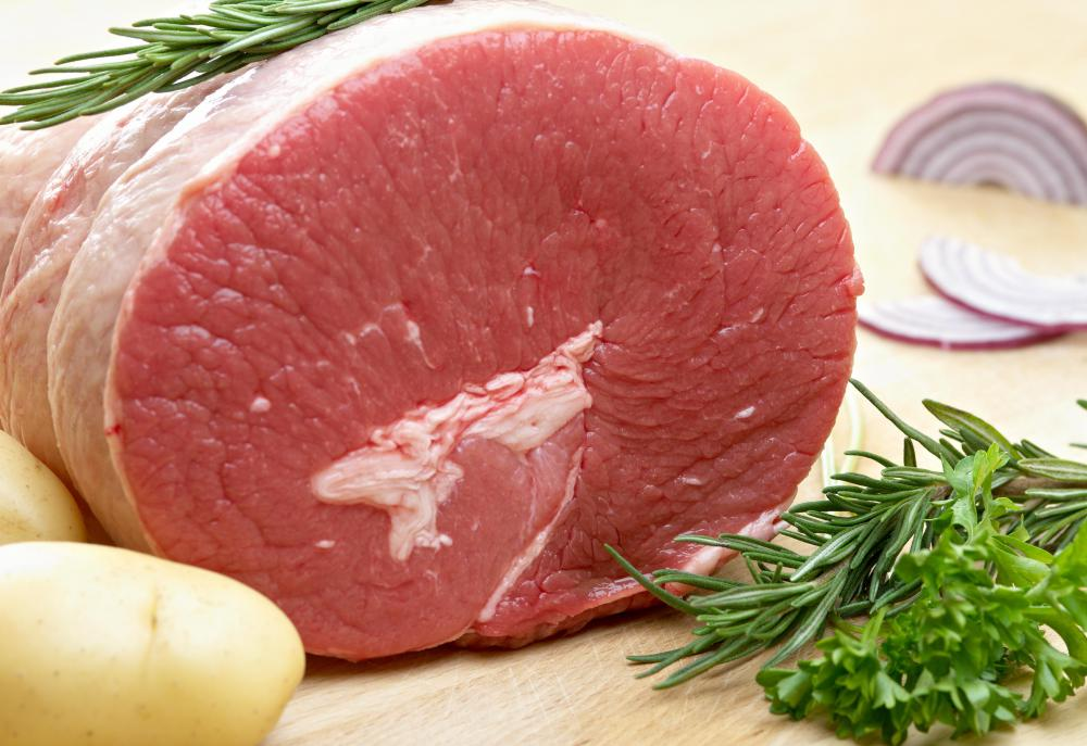 Garlic and parsley add flavor to roast beef.