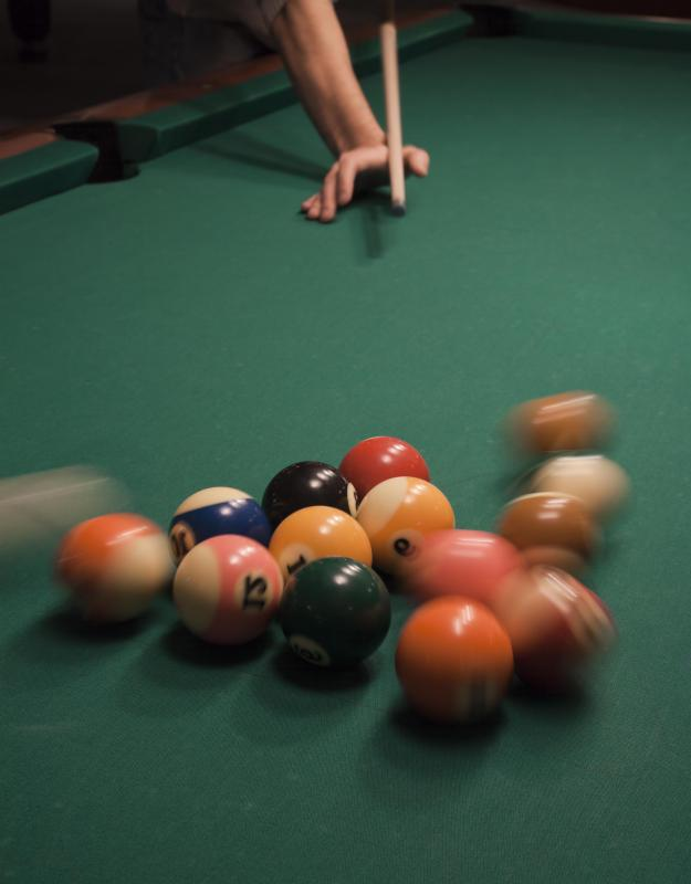 A cue lathe is used to make pool cues symmetrical and straight.