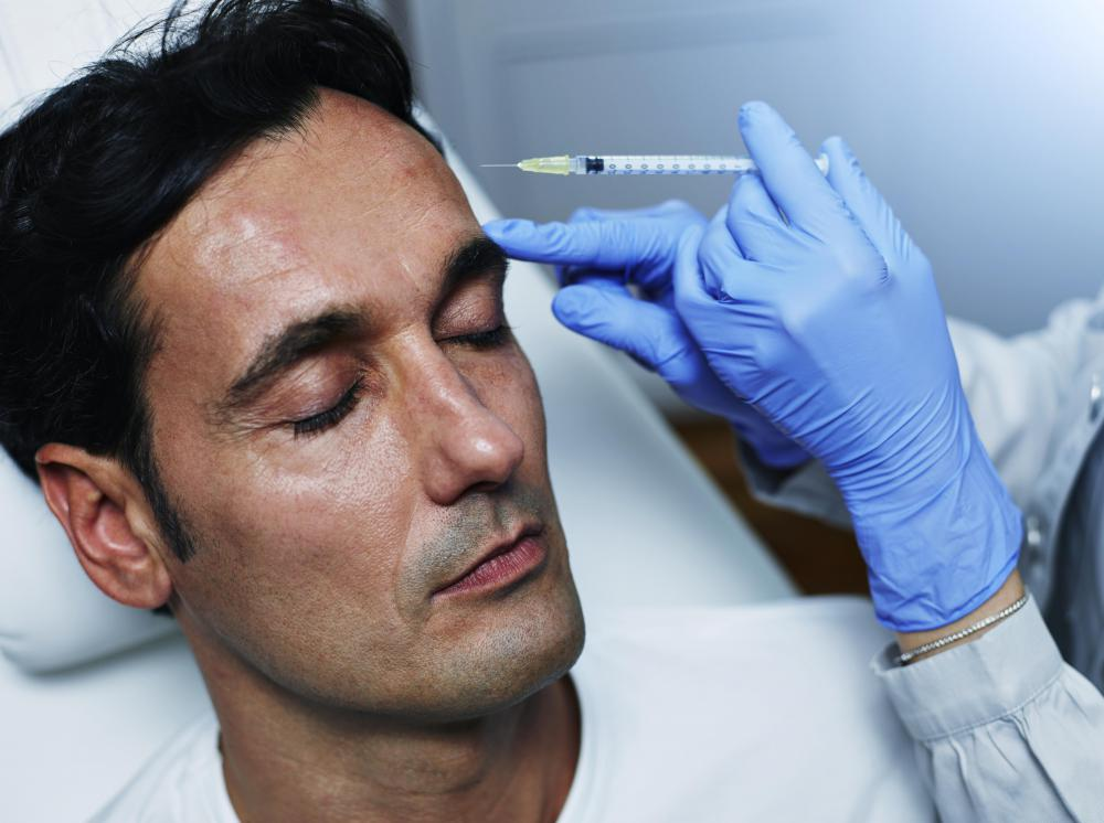 Botox injections paralyze the face's muscles, reducing the appearance of wrinkles, including those on the forehead.