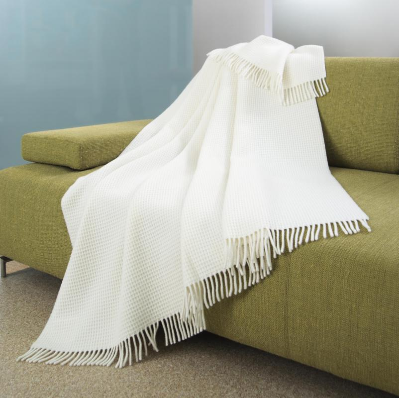 Throw blankets are typically used when making a photo blanket.