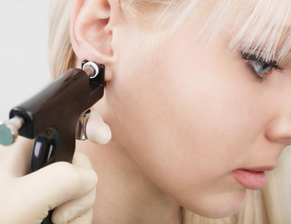 Ear gauges are used to stretch existing piercing holes to disproportionate sizes.