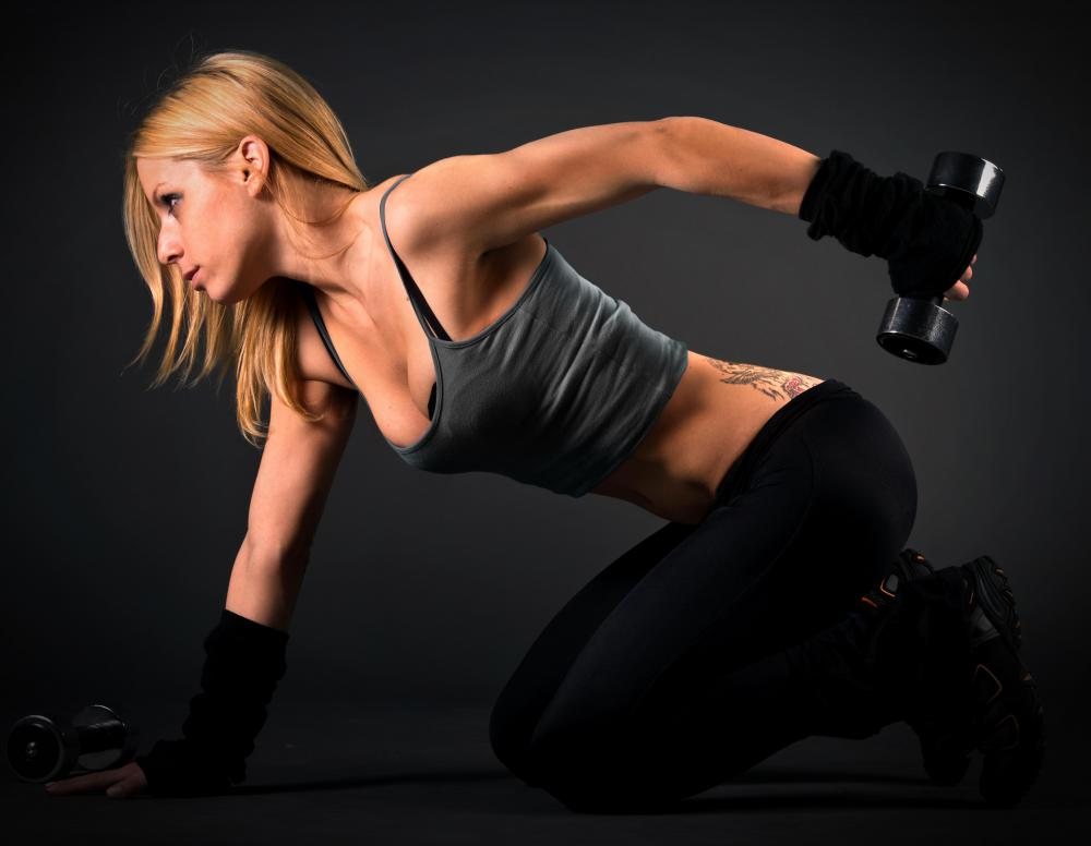 Triceps kickbacks, performed with dumbbells, are one method to tone the backs of the arms.