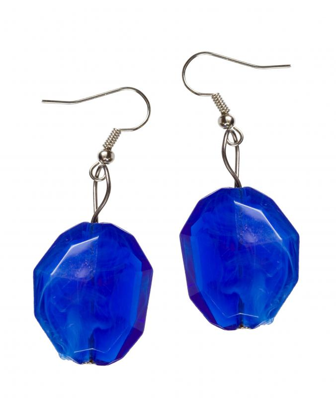Oval earrings, which often look good with a triangular face.