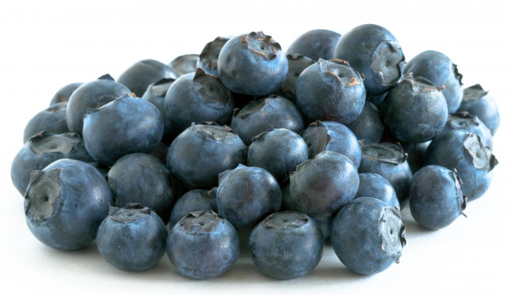 Blueberries provide a healthy and sweet addition to muffins.
