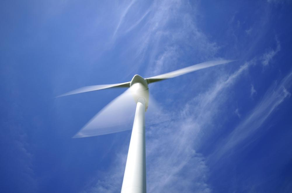 A television without Auto Motion Plus technology would show a somewhat blurred image of a fast-moving wind turbine.