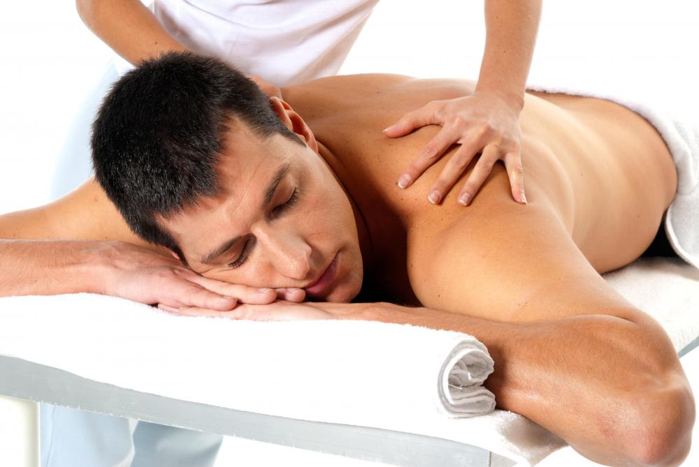 A man getting a massage at a spa.