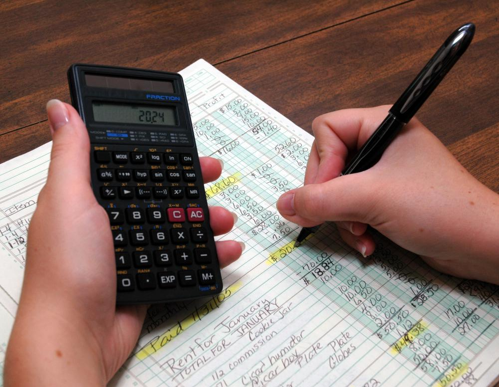 a bookkeeper reviewing a ledger