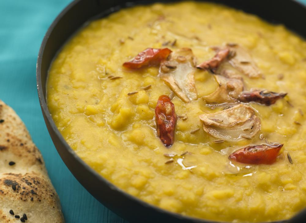 Dhal is typically stewed and flavored with several spices.