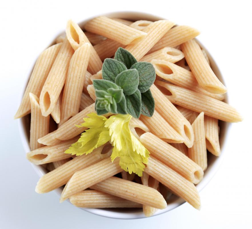 Whole-wheat pasta can be made into a variety of shapes and sizes, including penne pasta.