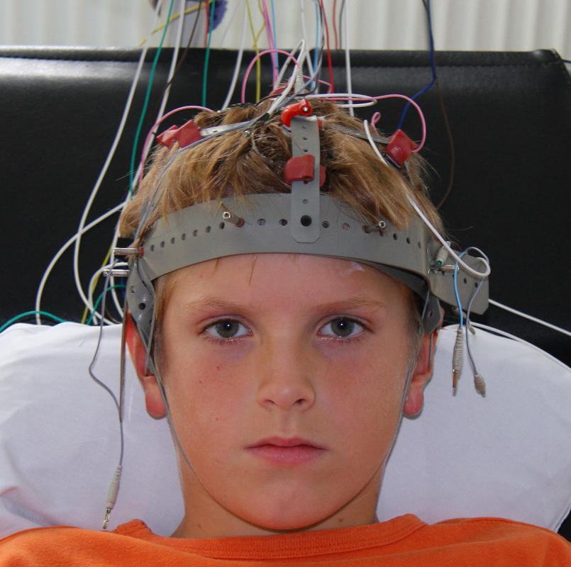 A boy connected to an EEG machine, which provides biofeedback.