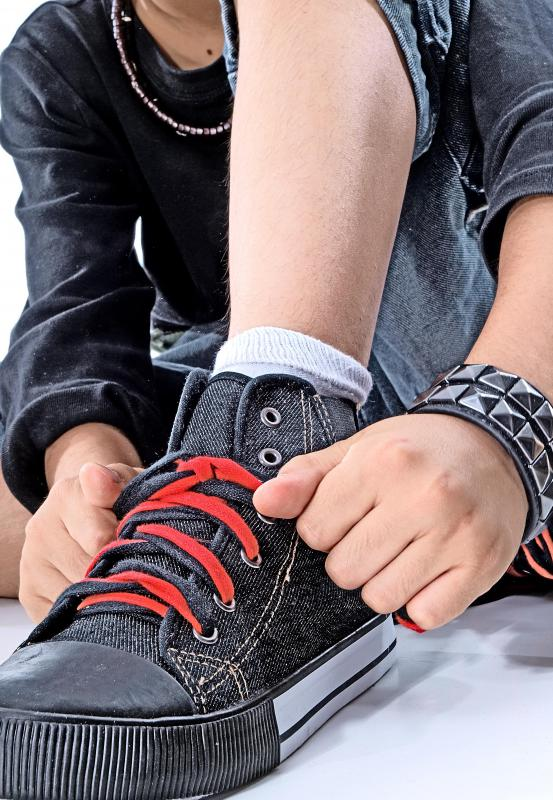 Mental retardation may interfere with a person's ability to engage in simple daily tasks, like tying shoes.
